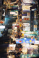Market stalls & people at the crowded Temple Street Night Market, Kowloon, Hong Kong, China.