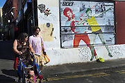 Graffiti on Brick Lane in East London reflecting the Cult of Jamaican runner Usain Bolt