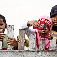 Children in Luwuk, Central Sulawesi take a photo of the strange Westerner
