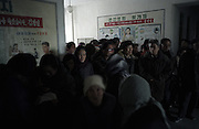 North Korea Eye Surgery Workshop. Patients gather and line up outside the area at Haeju hospital allocated for the eye examinations and surgery. Haeju is concidered one of the poorer areas of the country a primary agricultural area.