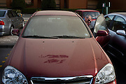 Manuel Jose, the Portuguese Coach of the Egyptian football team Al-Ahly examines his dusty car during his February 17, 2012 return to the Ahly club stadium in Cairo, Egypt. Jose returned to Egypt Feb 16 after a 2 week break to resume his job of coach of Al-Ahly in the wake of post-football match violence February 2nd, 2012 that killed 74 and injured hundreds more in the Port Said, Egypt stadium.  (Photo by Scott Nelson)