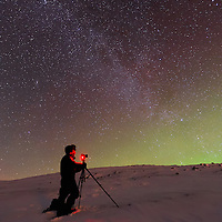 The Aurora, the Milky Way, and me on top of Mount Nuolja.