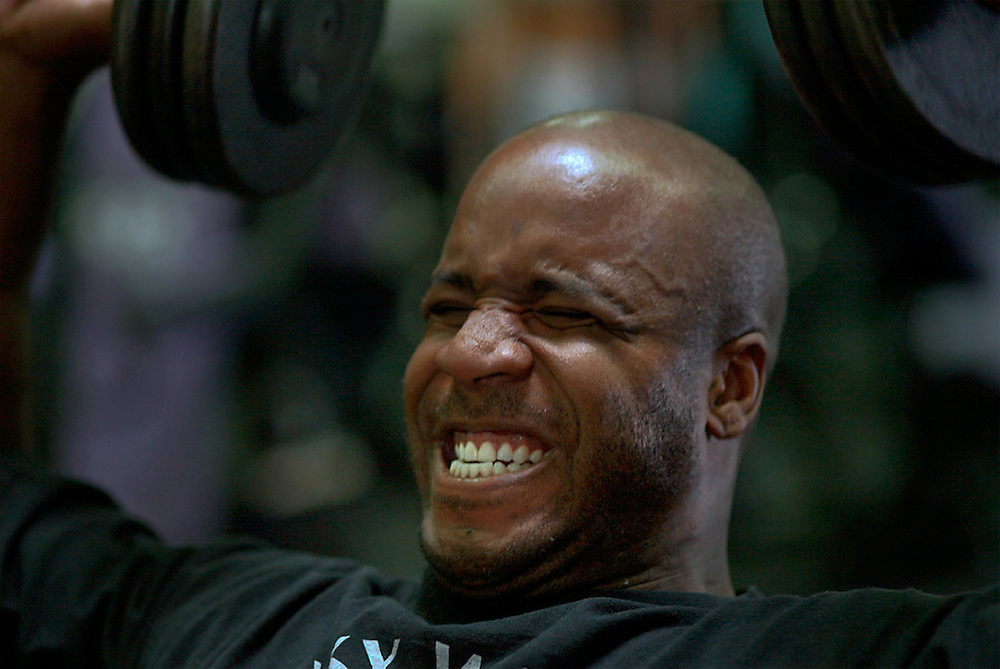 Barry Bonds lifts weights at his local gym in San Mateo, California.