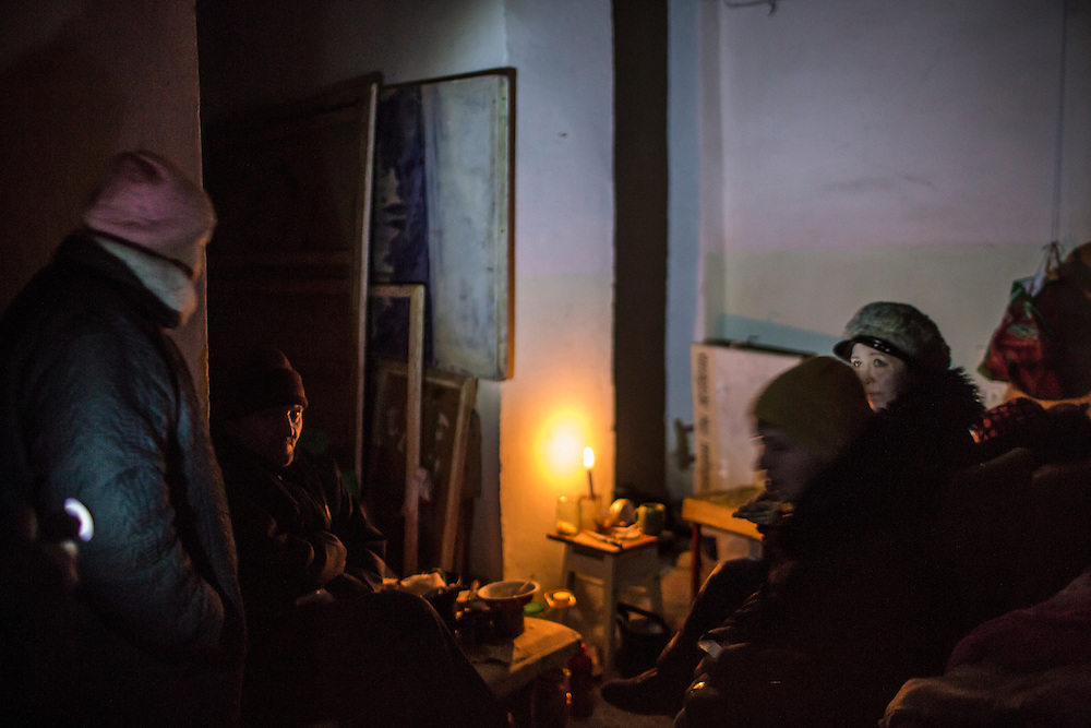 MYRONIVSKYI, UKRAINE - FEBRUARY 17: People sit inside a bomb shelter at the local House of Culture on February 17, 2015 in Myronivskyi, Ukraine. A ceasefire agreed to by Ukraine and pro-Russian rebel forces has failed to prevent fighting in the nearby town of Debaltseve, where thousands of Ukrainian troops remain and whom rebels claim to have surrounded. (Photo by Brendan Hoffman/Getty Images) *** Local Caption ***