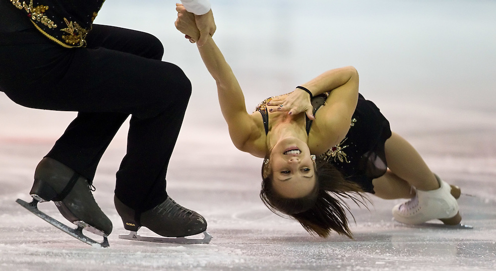 GJR -20111028- Mississauga, Ontario,Canada-  Meagan Duhamel of Canada is spun by her partner Eric Radford during their short program at Skate Canada International, October 28, 2011.<br /> AFP PHOTO/Geoff Robins