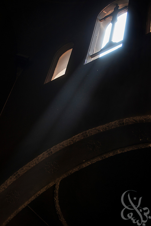 Light streams through a high window inside the burned and looted Virgin Mary Church August 20, 2013 after a recent attack by Muslims in the village of Nazla, near el Fayoum, around a 100 kilometers South of Cairo, Egypt.  Coptic Christian villagers report 2 churches and a monastery in the area came under attack by their Muslim neighbors on the same day as Egyptian security forces were moving to forcibly disperse the sit-in camp of the supporters of deposed president Mohamed Morsi.