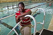 Tefiro Serunjogi '15 poses for a portrait on the steps of the Russell K. Osgood pool. BEN BREWER/Grinnell College