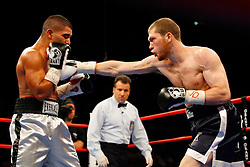 Nov 8, 2008; New York, NY, USA; Dmitriy Salita (Blue/Gold) and Derrick Campos (Silver/Black) trade punches during their 12 round fight at Madison Square Garden in New York, NY.