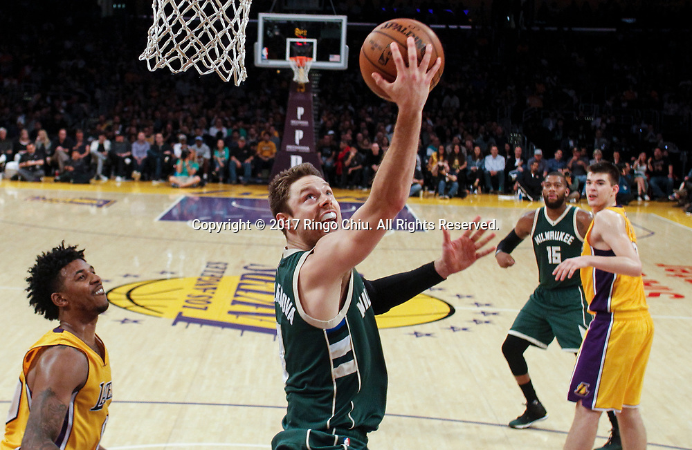 Milwaukee Bucks guard Matthew Dellavedova (#8)  goes up for a layup against Los Angeles Lakers during an NBA basketball game, Friday, March 17, 2017.(Photo by Ringo Chiu/PHOTOFORMULA.com)<br /> <br /> Usage Notes: This content is intended for editorial use only. For other uses, additional clearances may be required.