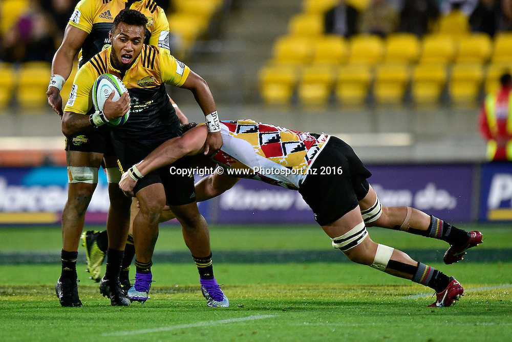 Willis Halaholo (L) of the Hurricanes is tackled by Stefan Willemse of the Southern Kings during the Hurricanes vs Kings Super Rugby  match at the Westpac Stadium in Wellington on Friday the 25th of March 2016. Copyright Photo by Marty Melville / www.Photosport.nz