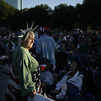 A woman dressed as the Statue of Liberty awaits the start of the Pops Goes the Fourth Concert at the Hatch Shell in July 4, 2009 in Boston, Massachusetts.  Photo by Matthew Healey