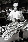 SHOT 4/1/09 10:08:20 AM - Sushi Den sushi chef Young Jo Kwon of Denver helps as the restaurant's sushi chefs prepare some 600 pounds of fresh fish shipped in from Japan at the Pearl Street sushi restaurant. Kwon has worked at the restaurant for about a year. Sushi Den is consistently ranked as one of Denver's best restaurants.  The owners strive to create one of the top sushi restaurants in the world by providing consistently fresh, innovative healthy foods using only the finest ingredients..(Photo by Marc Piscotty / © 2009)