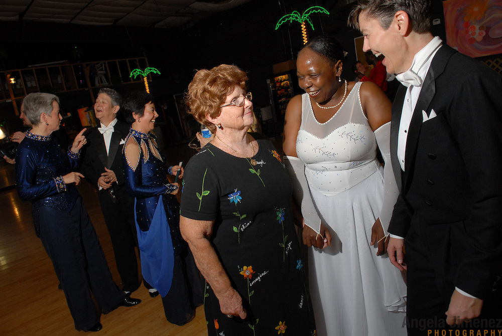 Female same-sex ballroom dancers Jean Matuska, far right, of San Francisco, and Sheila Dodd, of Oakland, California, greet Jacquelyn Lamberty after competing in the women's standard category at the USADSF (United States Alternative Dancesport Federation) Same-Sex Ballroom Championships at Dance Orlando in Orlando, Florida on June 2, 2007...Lamberty's son, Richard, who is from Orlando, organized and hosted the event with his dance partner Stuart Nichols. It was the first time his mother had seen him compete in same-sex dancing live. ..The other dancers pictured are Ann Taylor, from far left, of Alton, Illinois, Barbara Zoloth, of Berkeley, California and Sonja Furiya, also of Alton, Illinois. ..Nine male and female couples from around the country competed in the event, which was the 3rd annual United States championship contested in this sport: the first two championships were held in Sacramento, California in 2005 and 2006. This was the first same-sex ballroom competition ever held in Florida. ..Same-sex ballroom dancing is a new sport which is growing and developing in the United States, but it has a longer history in Europe, where events have been held for over two decades.  .