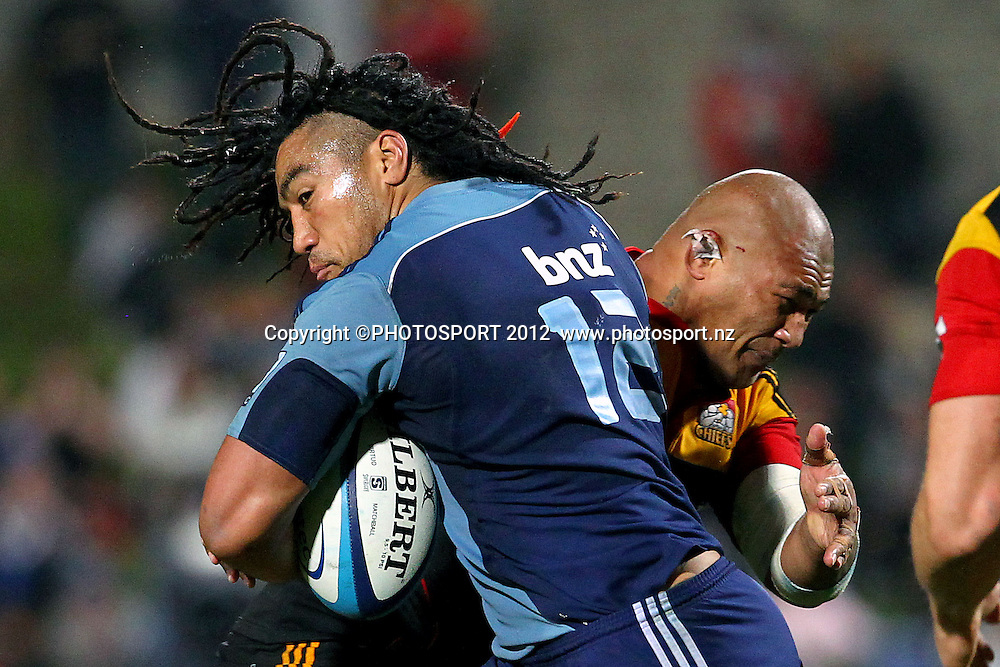 Blues' Ma'a Nonu takes on Chiefs' Arizona Taumalolo. Super Rugby rugby union match, Blues v Chiefs at North Harbour Stadium, Auckland, New Zealand. Saturday 2nd June 2012. Photo: Anthony Au-Yeung / photosport.co.nz