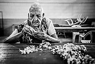 """BARQUISIMETO, VENEZUELA - JULY 28, 2016: Patients pick at blocks recycled material, breaking it into small pieces for hours a day. It is a low cost form of therapy that doctors at El Pampero invented to help psychiatric patients relieve their anxiety. Before the crisis, when patients were receiving all the medicines they needed - and the hospital had healthy government funding, they had a much more robust therapy program.  They held weekly sewing, cooking, and sculpture classes.  They had a farming program where patients grew fresh vegetables, and a sports program.  Now, there is no funding for any sort of therapy except picking at the blocks of recycled material, and unmedicated patients are too unstable to do those types of activities anymore.  """"When patients have their medicines, they can do really complex crafts. Now they just do simple tasks,"""" said art therapist Mirthis Fernández.  PHOTO: Meridith Kohut for The New York Times"""