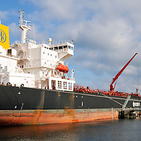 Fuel oil tanker ship Ice Beam offloading fuel at terminal