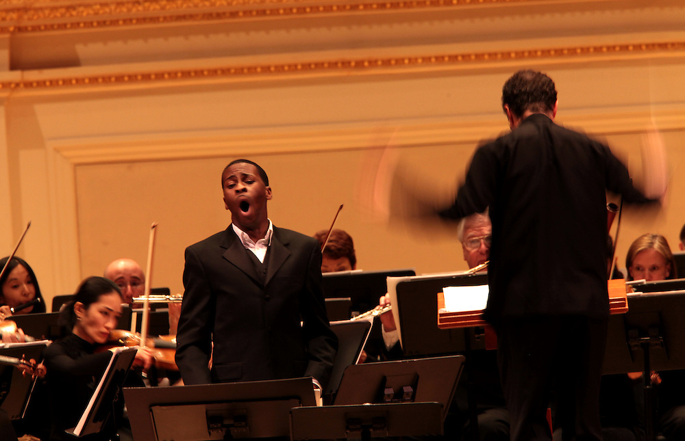 American baritone Nathan De'Shon Myers performing songs from The Spirituals Project with the Albany Symphony with music director David Alan Miller at the Spring for Music festival at Carnegie Hall in Manhattan, New York on May 10, 2011. .