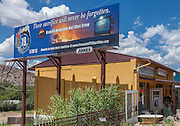 A billboard paying tribute to the 19 members of the Granite Mountain Hot Shot Crew who died fighting the Yarnell Hill Fire in July, 2013, in Yarnell, Arizona.