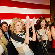 Wendy Davis, flanked by her father, Jerry Russell at left and her two daughters, right, applauds her supporters during her victory speech at the Fort Worth Hilton on November 6, 2012.<br />