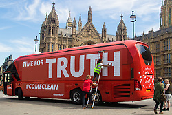 """Old Palace Yard, Westminster, July 18th 2016. Greenpeace protest against the """"exaggeration and lies"""" of the Vote Leave campaign in the EU referendum by taking over they campaign's bus on which was emblazoned the promise of an extra £350 million for the NHS, which days after the referendum Brexit campaigners distanced themselves from. Covering the cuts in """"Time for Truth"""" made up of hundreds of questions from members of the public, the bus, parked outside Parliament is a stark admonishment against dishonest politics."""