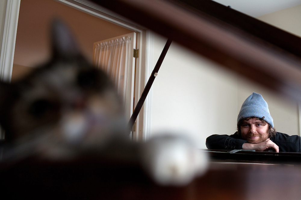 NEW YORK, NY - MARCH 25: Composer, songwriter and performer Gabriel Kahane with his cat Roscoe at his home in Brooklyn, NY on March 25, 2013. .Kahane is a 31-year-old composer of the 'indie-classical' genre who has two performances coming up in Washington D.C., one sponsored by the Library of Congress in which he appears in recital with another composer/performer, and one with the Orpheus Chamber Orchestra; he's their first composer in residence and has written a new work that's a portrait of the USA based on WPA travel guides from the 1930s. Last year his musical FEBRUARY HOUSE got rave reviews for its run at the Public Theater in NY.
