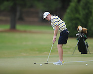 Oxford High's Ward Toler putts on the 4th hole during the opening round of the MHSAA Class 5A state championship golf tournament at the Ole Miss Golf Course in Oxford, Miss. on Wednesday, May 1, 2013.