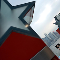 A couple kisses on the Avenue of Stars on the Tsim Sha Tsui waterfront promenade in Hong Kong. (Photo/Scott Dalton)