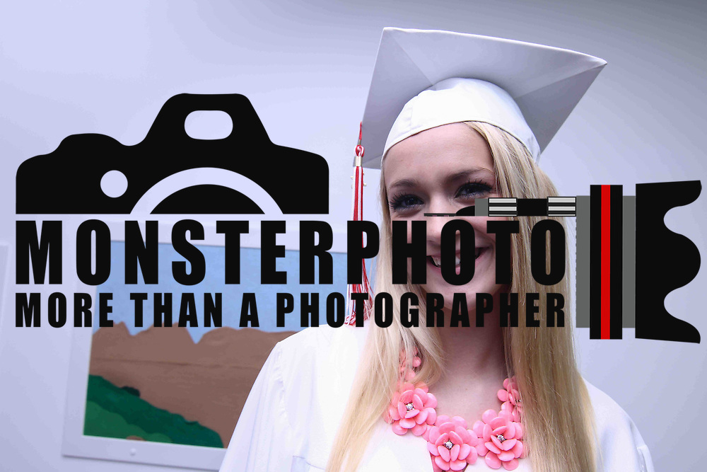 Red Lion Christian Academy Graduate Emily Harrison pose for a photo prior to commencement exercise Friday, May 29, 2015, at Glasgow Church in Bear, Delaware.
