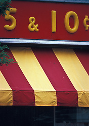 Colorful red and yellow store awning of small town old fashioned 5 & 10 cents store.
