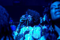 A fan snaps a photo during the MMG Tour in Providence, Rhode Island at the Dunkin Donuts Center on November, 16, 2012.  Photo by Matthew Healey