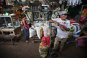 A porter takes a break at the Huembes market in Managua