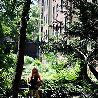 Portrait of a young woman.   Young dancer in Jackson Heights. The area was cross-influenced by several movements: New York housing reform at the close of the 19th century and the British Garden City Movement at the dawn of the 20th century. It was further influenced by urban housing innovations in Europe generally, and in Charlottenburg, Germany specifically.