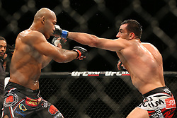 Ledyard, Connecticut, USA - September 5, 2014: Ronaldo Souza (black trunks) and Gegard Mousasi (red/white trunks) during their main event bout at UFC Fight Night at the Grand Theater at Foxwoods Resort Casino in Ledyard, Connecticut.  Ed Mulholland for ESPN