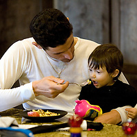 Discovery Channel Pro Cycling Team racer George Hincapie eats with his daughter Julia at home. Long successful in the European classics, in addition to being Lance Armstrong's right hand man on the team, Hincapie took his first Tour de France stage win in 2005.<br />