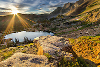 Sunrise in Utah's Wasatch Mountains overlooking Cecret Lake in Little Cottonwood Canyon.
