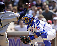 CHICAGO - APRIL 14:  Geovany Soto #18 of the Chicago Cubs prepares to tag out Prince Fielder #28 of the Milwaukee Brewers at home plate on April 14, 2010 at Wrigley Field in Chicago, Illinois.  The Cubs defeated the Brewers 7-6.  (Photo by Ron Vesely)