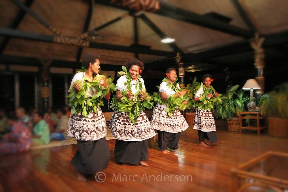 Fijian Women dancing traditional style in Fiji.