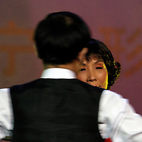 """BEIJING, 18 DECEMBER 2004: Liu Yulan, 62, the oldest participant of the """"first worldwide artificial beauty pageant """" ,shows her ballroom dancing skills in a theatre in Beijing, 18 December , 2003, in China...Beauty business in China , from cosmetic surgeries to hair brush sales, has amounted to more than USD 7 billion in 2003. The contest for women who have undetgone plastic surgery was organized after Yang Yuan, a young would-be model, was disqualified earlier on this year when organizers discovered that she'd had plastic surgery. Yang was present during the contest to introduce her biography that explains why she has the right to """"improve"""" her natural features... .."""