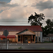Railroad tracks and storm clouds with an old vacant store Waverly, Virginia along Rt. 460. South of the James. .