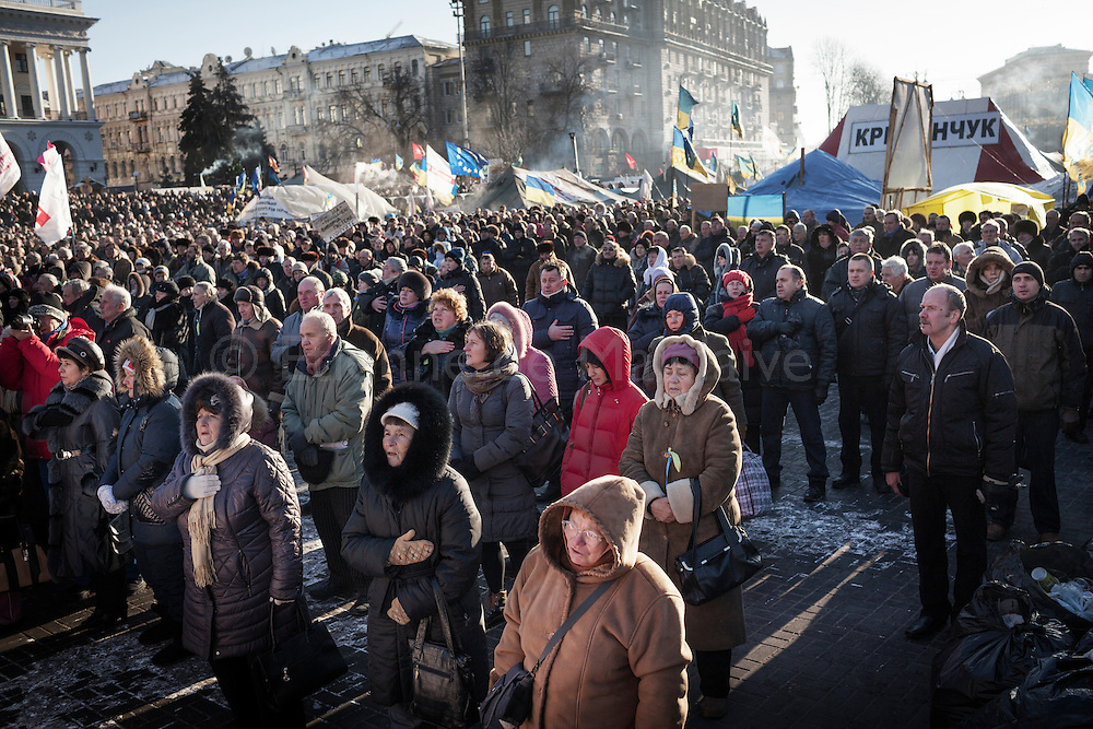 Large crowd of anti-government protesters  sing the national Ukrainian anthem as they attend the Sunday demonstration on Maidan Square  in Kiev., 02 February 2014.