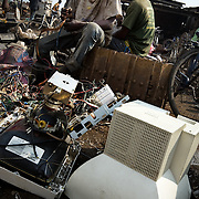 Young men pull apart the contents of computer monitors and other electronics to recover copper and other metals that can be sold for money at the Agbogboloshie market in Accra, Ghana on Thursday August 21, 2008.