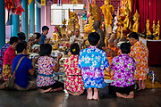 Members of the the congregation present the monks with breakfast at the local temple on the first day of Songkran in Nakhon Nayok, Thailand, April 13, 2017. PHOTO BY LEE CRAKER