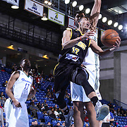 Delaware 87ers Guard Jared Cunningham (17) drives towards the basket as Reno Bighorns Center Sim Bhullar (44) defends in the first half of a NBA D-league regular season basketball game between the Delaware 87ers and the Reno Bighorns (Sacramento Kings), Tuesday, Feb. 10, 2015 at The Bob Carpenter Sports Convocation Center in Newark, DEL
