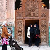 North Africa, Africa, Morocco, Marrakesh. Female tourists at the Ben Youssef Madrassa in Marrakesh.
