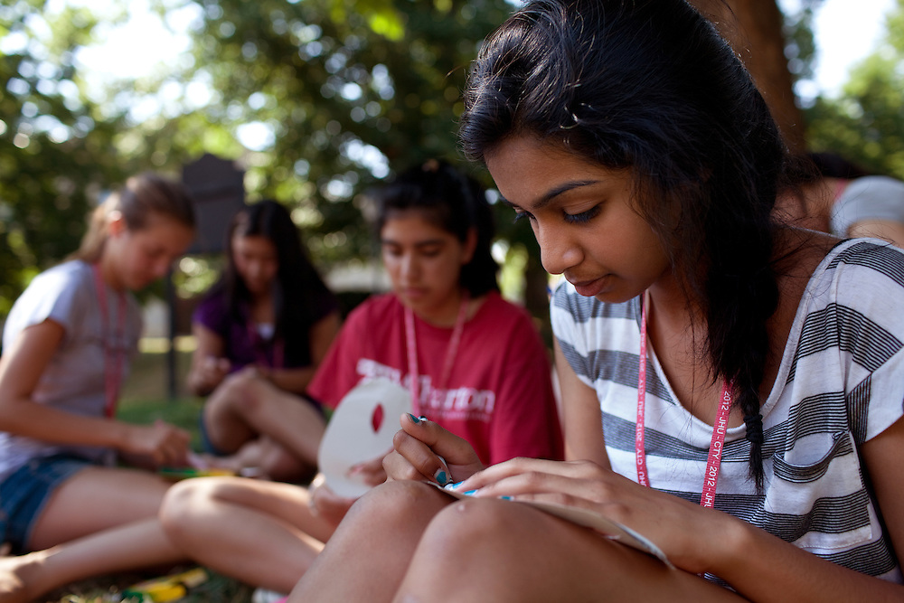 Geetika Guruprasad, 14, right, makes a mask for the evening's Masquerade Ball during Afternoon Activities at the Center for Talented Youth summer program at Lafayette College in Easton, PA on July 06, 2012. Several students were part of the Rural Connections scholarship program being offered for the first time this year.