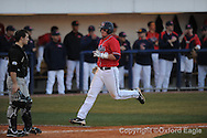 Mississippi's Matt Smith scores vs. Oakland in Oxford, Miss. on Friday, February 26, 2010. Ole Miss won 9-1.