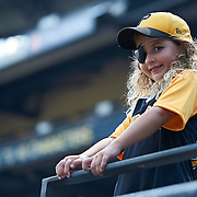 Seven year old Pittsburgh Pirates fan, Lily Stevens from Fredrick, MD, enjoys batting practice before the Pirates game against the Cincinnati Reds at PNC Park in Pittsburgh on August 30, 2014.  ©2014 Shelley Lipton.