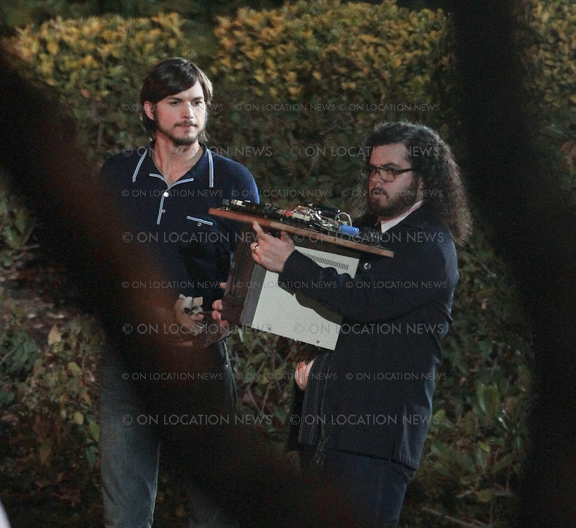 June 21st 2012 - Santa Clarita, CA. ***EXCLUSIVE*** <br /> Ashton Kutcher filming a scene for &quot;Jobs'. In this scene filmed on a on a college campus it is suppose to be the year 1973 which is the year Steve Job's dropped out of college. Ashton Kutcher as Steve Jobs and and actor Josh Gad as Apple co-founder Steve Wozniak film a scene in which they carry a prototype computer they built and also meet a business person while Ashton's character is in bare feet and carrying his sandals. <br /> Photos by Eric Ford/ On Location News 818-613-3955 info@onlocationnews.com