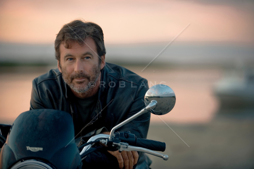portrait-of-a-very-handsome-rugged-man-on-a-motorcycle-by-the-bay-in    Handsome Rugged Man