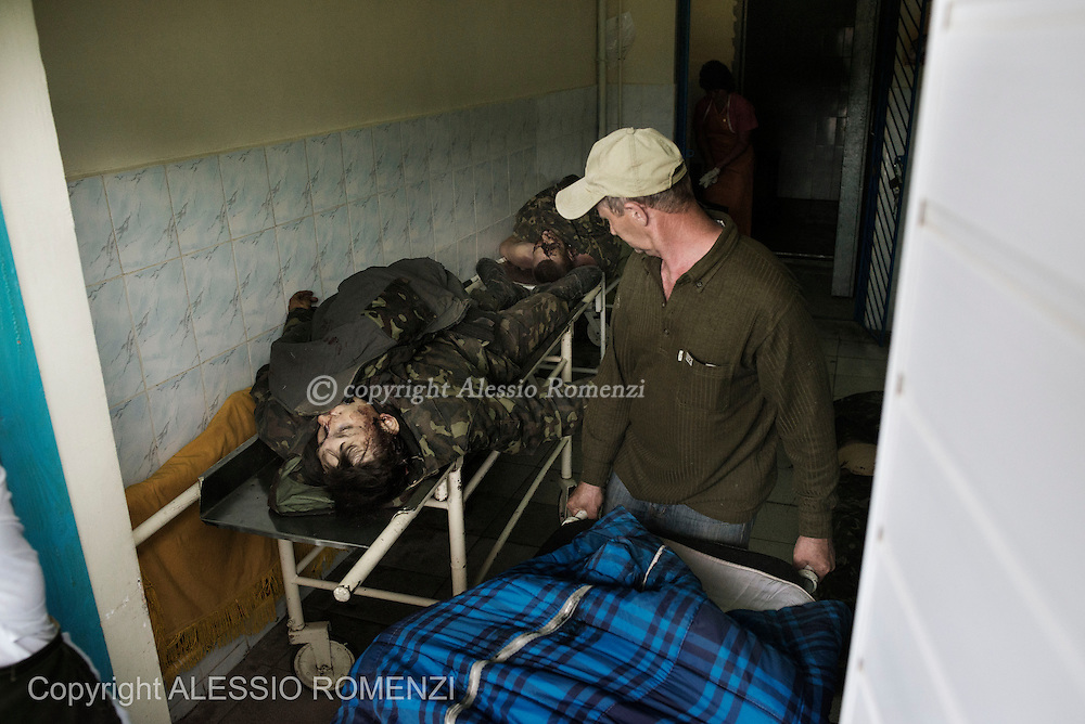 Ukraine, Volnovakha. The body of an Ukrainian soldier is carried inside the morgue of Volnovakha's hospital on May 22. At dawn an Ukrainian army check point near the village of Blahodatne has been attacked by unknown armed men and have been reported at least 13 killed and 30 injured. ALESSIO ROMENZI